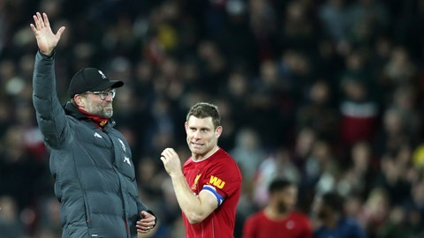 <p>               Liverpool's manager Jurgen Klopp, left, celebrates at the end of the English League Cup soccer match between Liverpool and Arsenal at Anfield stadium in Liverpool, England, Wednesday, Oct. 30, 2019. (AP Photo/Jon Super)             </p>