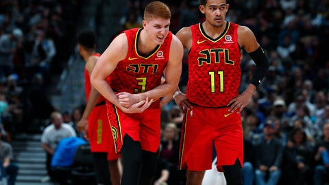 <p>               Atlanta Hawks guard Kevin Huerter, left, holds his left wrist next to Trae Young, who walks with Huerter to the bench during the second half of an NBA basketball game against the Denver Nuggets on Tuesday, Nov. 12, 2019, in Denver. Huerter left the game. Atlanta won 125-121. (AP Photo/David Zalubowski)             </p>