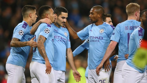 <p>               Manchester City players celebrate with Ilkay Gundogan, center, after he scored his side's first goal during the group C Champions League soccer match between Manchester City and Shakhtar Donetsk at the Etihad Stadium in Manchester, England, Tuesday, Nov. 26, 2019. (AP Photo/Dave Thompson)             </p>