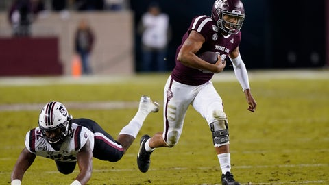 <p>               Texas A&M quarterback Kellen Mond, right, breaks away from South Carolina defensive lineman Kingsley Enagbare (52) as he rushes for a first down during the second quarter of an NCAA college football game Saturday, Nov. 16, 2019, in College Station, Texas. (AP Photo/David J. Phillip)             </p>