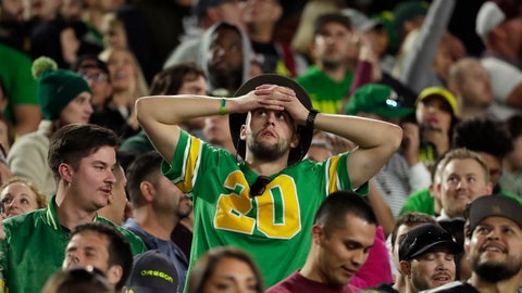 <p>               An Oregon fan reacts during the final seconds of the team's NCAA college football game against Arizona State, Saturday, Nov. 23, 2019, in Tempe, Ariz. Arizona State won 31-28. (AP Photo/Matt York)             </p>