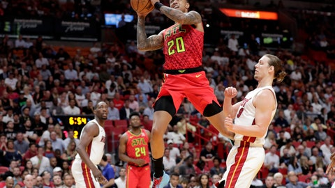 <p>               Atlanta Hawks forward John Collins (20) drives to the basket past Miami Heat forward Kelly Olynyk during the first half of an NBA basketball game Tuesday, Oct. 29, 2019, in Miami. (AP Photo/Lynne Sladky)             </p>