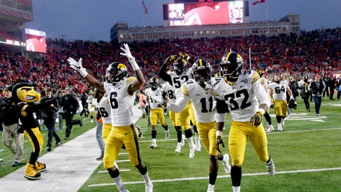 <p>               Iowa players including wide receiver Ihmir Smith-Marsette (6) and defensive back Michael Ojemudia (11) celebrate following an NCAA college football game against Nebraska in Lincoln, Neb., Friday, Nov. 29, 2019. Iowa won 27-24. (AP Photo/Nati Harnik)             </p>