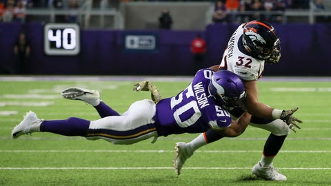 <p>               Denver Broncos fullback Andy Janovich (32) is tackled by Minnesota Vikings linebacker Eric Wilson (50) during the first half of an NFL football game, Sunday, Nov. 17, 2019, in Minneapolis. (AP Photo/Jim Mone)             </p>