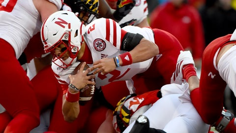 <p>               Nebraska quarterback Adrian Martinez (2) runs against Maryland defenders during the first half of an NCAA college football game, Saturday, Nov. 23, 2019, in College Park, Md. (AP Photo/Will Newton)             </p>