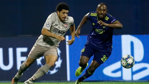 <p>               Shakhtar's Taison, left, and Dinamo Zagreb's Kevin Theophile-Catherine challenge for the ball during the group C Champions League soccer match between Dinamo Zagreb and Shakhtar Donetsk at Maksimir Stadium in Zagreb, Croatia, Wednesday, Nov. 6, 2019. (AP Photo/Darko Bandic)             </p>