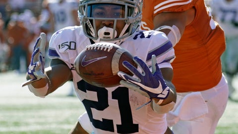 <p>               Kansas State's Wykeen Gill (21) hauls in a pass for a touchdown in front of Texas's Brandon Jones (19) during the first half of an NCAA college football game in Austin, Texas, Saturday, Nov. 9, 2019. (AP Photo/Chuck Burton)             </p>