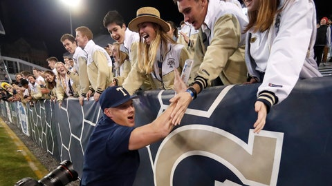 <p>               Georgia Tech coach Geoff Collins celebrates with fans after Georgia Tech defeated North Carolina State 28-26 in an NCAA college football game Thursday, Nov. 21, 2019, in Atlanta. (AP Photo/John Bazemore)             </p>