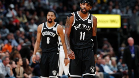 <p>               Brooklyn Nets guards Kyrie Irving, front, and Spencer Dinwiddie head to the bench during a timeout late in the second half of the team's NBA basketball game against the Denver Nuggets on Thursday, Nov. 14, 2019 in Denver. The Nuggets won 101-93. (AP Photo/David Zalubowski)             </p>