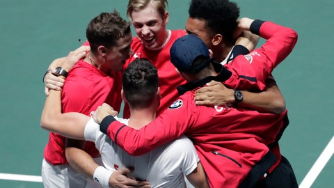 <p>               Canada's Vasek Pospisil, left, and his partner Denis Shapovalov, second left, celebrate with team captain Frank Dancevic and teammates after winning their Davis Cup semifinal doubles match against Russia's Karen Khachanov and Andrey Rublev, in Madrid, Spain, Saturday, Nov. 23, 2019. (AP Photo/Bernat Armangue)             </p>