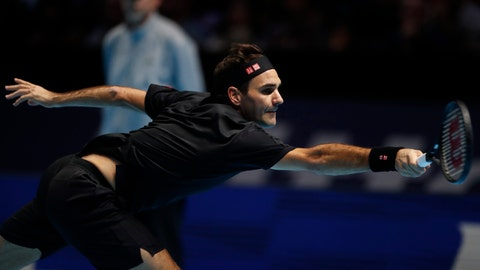 <p>               Switzerland's Roger Federer plays a return to Italy's Matteo Berrettini during their ATP World Tour Finals singles tennis match at the O2 Arena in London, Tuesday, Nov. 12, 2019. (AP Photo/Alastair Grant)             </p>