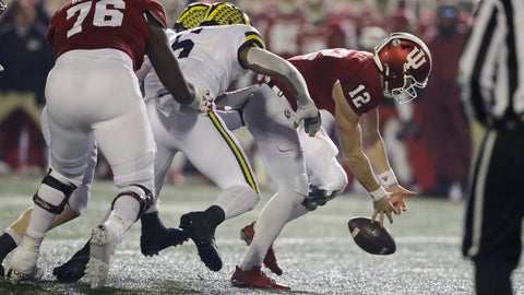 <p>               Indiana quarterback Peyton Ramsey (12) tries to recover a fumble after being hit by Michigan linebacker Josh Uche (6) during the second half of an NCAA college football game, Saturday, Nov. 23, 2019, in Bloomington, Ind. Michigan won 39-14. (AP Photo/Darron Cummings)             </p>