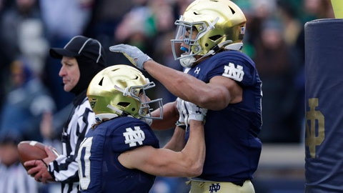 <p>               Notre Dame wide receiver Chase Claypool (83) celebrates his touchdown against Boston College with wide receiver Chris Finke (10) during the first half of an NCAA college football game in South Bend, Ind., Saturday, Nov. 23, 2019. (AP Photo/Michael Conroy)             </p>