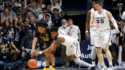 Nov 12, 2019; Cincinnati, OH, USA; Xavier Musketeers guard Paul Scruggs (1) goes for the ball during the second half against the Missouri Tigers guard Dru Smith (12) at the Cintas Center. Xavier won 63-58 in overtime. Mandatory Credit: Frank Victores-USA TODAY Sports