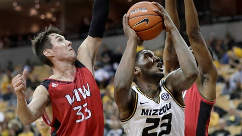 Missouri's Jeremiah Tilmon (23) looks to the basket as Incarnate Word's Vincent Miszkiewicz (33) defends during the second half of an NCAA college basketball game Wednesday, Nov. 6, 2019, in Columbia, Mo. (AP Photo/Jeff Roberson)