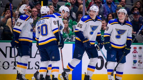 Nov 29, 2019; Dallas, TX, USA; St. Louis Blues left wing Zach Sanford (12) and center Ryan O'Reilly (90) and defenseman Alex Pietrangelo (27) and center Robert Thomas (18) celebrate a goal by defenseman Colton Parayko (55) against the Dallas Stars during the first period at the American Airlines Center. Mandatory Credit: Jerome Miron-USA TODAY Sports