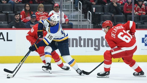 Oct 27, 2019; Detroit, MI, USA; St. Louis Blues center Robby Fabbri (15) handles the puck against Detroit Red Wings left wing Jacob de la Rose (61) and right wing Givani Smith (48) during the first period at Little Caesars Arena. Mandatory Credit: Tim Fuller-USA TODAY Sports