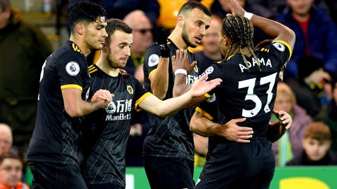 <p>               Wolverhampton Wanderers' Romain Saiss, centre, celebrates scoring his side's first goal of the game with his teammates during the English Premier League soccer match between Norwich and Wolverhampton Wanderers, at Carrow Road, in Norwich, England, Saturday Dec. 21, 2019. (Joe Giddens/PA via AP)             </p>