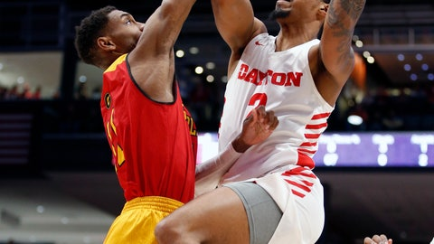 <p>               Dayton guard Ibi Watson (2) puts up a shot against Grambling State guard Kelton Edwards, left, during the first half of an NCAA college basketball game, Monday Dec. 23, 2019, in Dayton, Ohio. (AP Photo/Gary Landers)             </p>