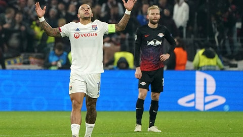 <p>               Lyon's Memphis Depay celebrates after he scored a goal during the group G Champions League soccer match between Lyon and RB Leipzig at the Lyon Olympic Stadium in Decines, outside Lyon, France, Tuesday, Dec. 10, 2019. (AP Photo/Laurent Cipriani)             </p>