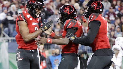 <p>               Louisville wide receiver Devante Peete, left, celebrates with quarterback Micale Cunningham, center, after they teamed up for a 24-yard pass completion for a touchdown against Mississippi State in the second half of the Music City Bowl NCAA college football game Monday, Dec. 30, 2019, in Nashville, Tenn. (AP Photo/Mark Humphrey)             </p>
