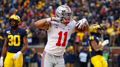 <p>               Ohio State wide receiver Austin Mack (11) celebrates after scoring on a 16-yard touchdown reception against Michigan in the second half of an NCAA college football game in Ann Arbor, Mich., Saturday, Nov. 30, 2019. (AP Photo/Paul Sancya)             </p>