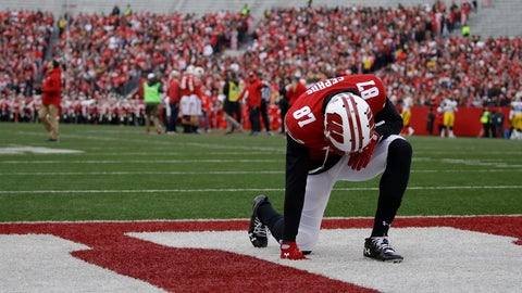 <p>               FILE - In this Nov. 9, 2019, file photo, Wisconsin's Quintez Cephus kneels before an NCAA college football game against Iowa, in Madison, Wis. Faith and family mean everything to Quintez Cephus. The junior wide receiver is enjoying the most productive season of his career at Wisconsin. But less than four months ago, football was gone, and all Cephus had was his faith and his family. (AP Photo/Aaron Gash, File)             </p>
