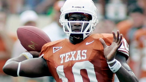 <p>               FILE - In this Nov. 12, 2005, file photo, Texas quarterback Vince Young looks to pass against Kansas during the second quarter of an NCAA college football game in Austin, Texas. Newly elected College Football Hall of Famers Darren McFadden, Vince Young and Lorenzo White never won the Heisman Trophy. Each was up for the award at a time when their credentials didn't quite fit the voting trends. (AP Photo/Eric Gay, File)             </p>