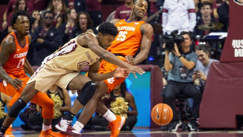 <p>               Clemson Aamir Simms attempts to take a charge from Florida State forward Malik Osborne (10) in the first half of an NCAA college basketball game in Tallahassee, Fla., Sunday, Dec. 8, 2019. (AP Photo/Mark Wallheiser)             </p>