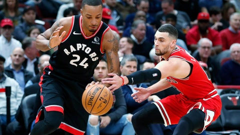 <p>               Toronto Raptors' Norman Powell (24) drives to the basket past Chicago Bulls' Zach LaVine during the first half of an NBA basketball game Monday, Dec. 9, 2019, in Chicago. (AP Photo/Charles Rex Arbogast)             </p>