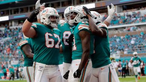 <p>               Miami Dolphins center Daniel Kilgore (67) congratulates wide receiver DeVante Parker (11) after Parker scored a touchdown during the second half at an NFL football game against the Philadelphia Eagles, Sunday, Dec. 1, 2019, in Miami Gardens, Fla. (AP Photo/Lynne Sladky)             </p>