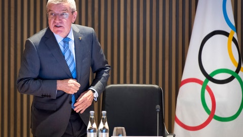 <p>               International Olympic Committee (IOC) president Thomas Bach from Germany speaks at the opening of the executive board meeting of the International Olympic Committee (IOC), at the Olympic House, in Lausanne, Switzerland, Tuesday, Dec. 3, 2019. (Laurent Gillieron/Keystone via AP)             </p>