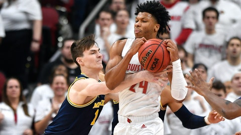 <p>               Michigan center Jon Teske (15) attempts to strip the ball away from Louisville forward Dwayne Sutton (24) during the first half of an NCAA college basketball game in Louisville, Ky., Tuesday, Dec. 3, 2019. (AP Photo/Timothy D. Easley)             </p>