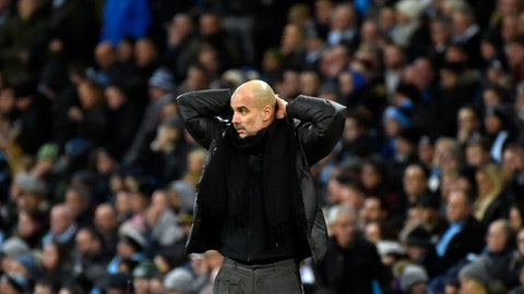 <p>               Manchester City's head coach Pep Guardiola reacts during the English Premier League soccer match between Manchester City and Manchester United at Etihad stadium in Manchester, England, Saturday, Dec. 7, 2019. (AP Photo/Rui Vieira)             </p>