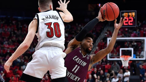 <p>               Eastern Kentucky guard Jomaru Brown (11) attempts to pass the ball as Louisville guard Ryan McMahon (30) defends during the first half of an NCAA college basketball game in Louisville, Ky., Saturday, Dec. 14, 2019. (AP Photo/Timothy D. Easley)             </p>