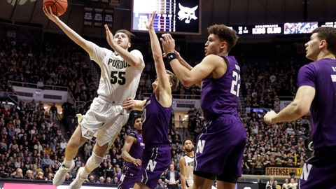 <p>               Purdue guard Sasha Stefanovic (55) shoots over Northwestern forward Pete Nance (22) and forward Miller Kopp (10) during the second half of an NCAA college basketball game in West Lafayette, Ind., Sunday, Dec. 8, 2019. Purdue defeated Northwestern 58-44. (AP Photo/Michael Conroy)             </p>