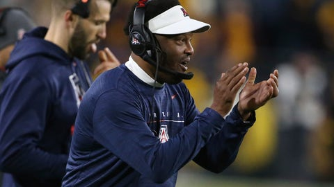 <p>               Arizona coach Kevin Sumlin claps in support of his team's defense against Arizona State during the first half of an NCAA college football game, Saturday, Nov. 30, 2019, in Tempe, Ariz. (AP Photo/Darryl Webb)             </p>