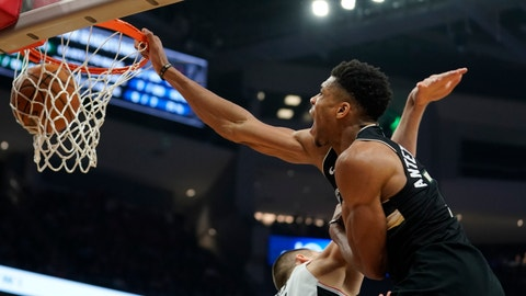 <p>               Milwaukee Bucks' Giannis Antetokounmpo dunks 0ver Los Angeles Clippers' Ivica Zubac during the second half of an NBA basketball game Friday, Dec. 6, 2019, in Milwaukee. (AP Photo/Morry Gash)             </p>