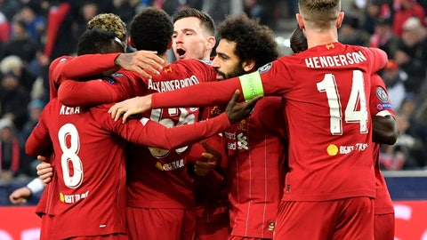 <p>               Liverpool's Naby Keita, left, celebrates with teammates after scoring his side's opening goal during the group E Champions League soccer match between Salzburg and Liverpool, in Salzburg, Austria, Tuesday, Dec. 10, 2019. (AP Photo/Kerstin Joensson)             </p>