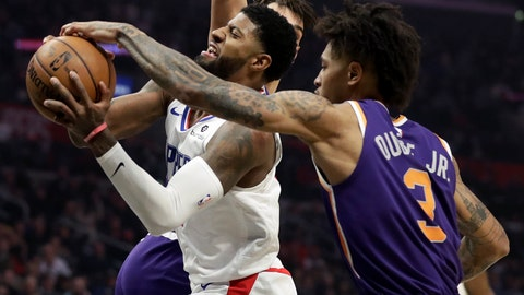 <p>               Phoenix Suns forward Kelly Oubre Jr., right, blocks a shot by Los Angeles Clippers forward Paul George during the first half of an NBA basketball game in Los Angeles, Tuesday, Dec. 17, 2019. (AP Photo/Chris Carlson)             </p>