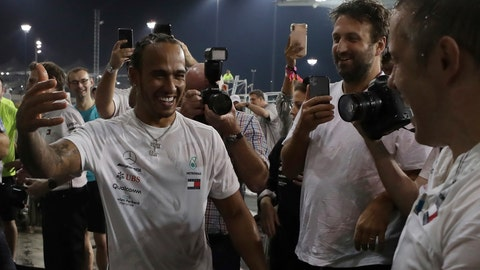<p>               Mercedes driver Lewis Hamilton of Britain, left, celebrates with team members after winning the Emirates Formula One Grand Prix at the Yas Marina racetrack in Abu Dhabi, United Arab Emirates, Sunday, Dec.1, 2019. (AP Photo/Hassan Ammar)             </p>
