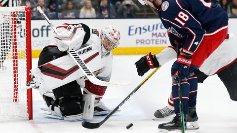 <p>               Arizona Coyotes' Darcy Kuemper, left, makes a save against Columbus Blue Jackets' Pierre-Luc Dubois during the second period of an NHL hockey game Tuesday, Dec. 3, 2019, in Columbus, Ohio. (AP Photo/Jay LaPrete)             </p>