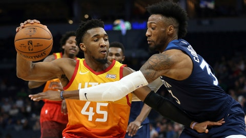 <p>               Utah Jazz's Donovan Mitchell controls the ball against Minnesota Timberwolves' Robert Covington in the first half of an NBA basketball game Wednesday, Dec. 11, 2019, in Minneapolis. (AP Photo/Stacy Bengs)             </p>