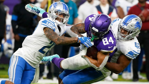 <p>               Minnesota Vikings tight end Irv Smith (84) is tackled by Detroit Lions defenders Darius Slay, left, and Devon Kennard, right, after catching a pass during the second half of an NFL football game, Sunday, Dec. 8, 2019, in Minneapolis. (AP Photo/Bruce Kluckhohn)             </p>