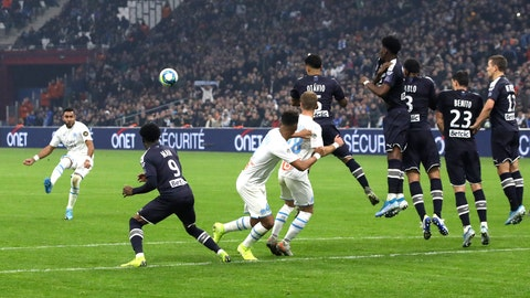 <p>               Marseille's Dimitri Payet shoots a free kick during the French League One soccer match between Marseille and Bordeaux at the Velodrome stadium in Marseille, southern France, Sunday, Dec. 08, 2019. (AP Photo/Daniel Cole)             </p>