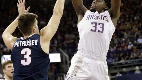 <p>               Washington's Isaiah Stewart (33) shoots over Gonzaga's Filip Petrusev (3) in the first half of an NCAA college basketball game Sunday, Dec. 8, 2019, in Seattle. (AP Photo/Elaine Thompson)             </p>