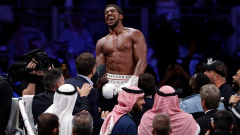 <p>               Britain's Anthony Joshua celebrates after beating Andy Ruiz Jr. to win their World Heavyweight Championship contest at the Diriyah Arena, Riyadh, Saudi Arabia. (AP Photo/Hassan Ammar)             </p>