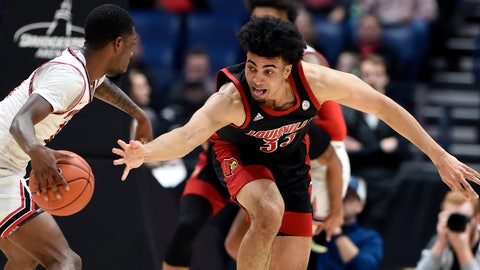 <p>               Louisville forward Jordan Nwora (33) reaches for the ball as he tries to knock it away from Western Kentucky guard Taveion Hollingsworth (11) during the second half of an NCAA college basketball game Friday, Nov. 29, 2019, in Nashville, Tenn. (AP Photo/Mark Zaleski)             </p>