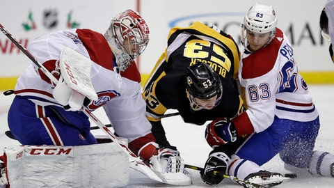 <p>               Pittsburgh Penguins' Teddy Blueger (53) can't get to a rebound off Montreal Canadiens goaltender Carey Price (31) with Matthew Peca (63) defending during the second period of an NHL hockey game in Pittsburgh, Tuesday, Dec. 10, 2019. (AP Photo/Gene J. Puskar)             </p>