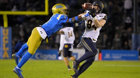 <p>               California tight end Gavin Reinwald, right, makes a catch as UCLA defensive back Darnay Holmes defends during the first half of an NCAA college football game Saturday, Nov. 30, 2019, in Pasadena, Calif. (AP Photo/Mark J. Terrill)             </p>